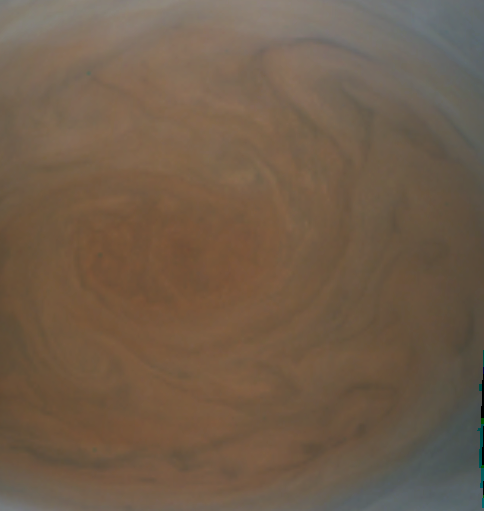 Close-up view of Jupiter's great red spot or storm that has been circling Jupiter's atmosphere for centuries